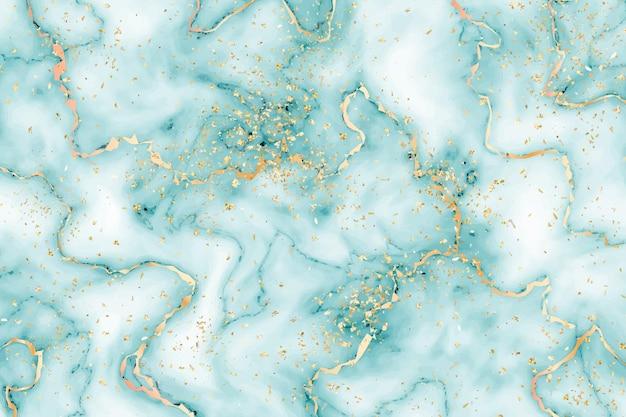 金のスプラッタと液体大理石の背景