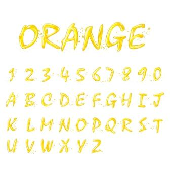 白い背景の上の液体のオレンジ色のアルファベットと数字のコレクション