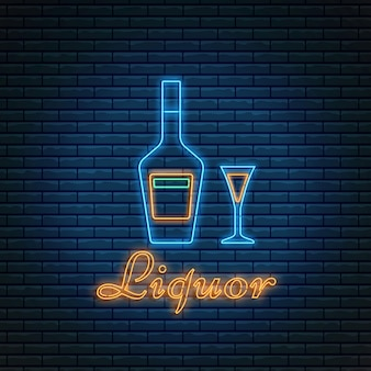 Liquor bottle and glass with lettering in neon style on brick background.