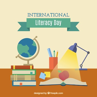 Literacy day with an open book and other items