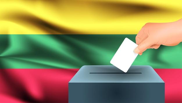 Флаг литвы, мужская рука голосование с фоном идеи концепции флага литвы