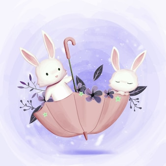 Little adorable bunnies playing with umbrella