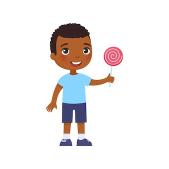 Little african happy boy smiles and holds a pink lollipop in his hand. cartoon dark skin character