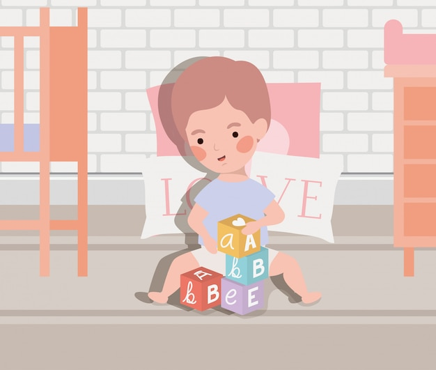 Little baby boy playing with alphabet blocks