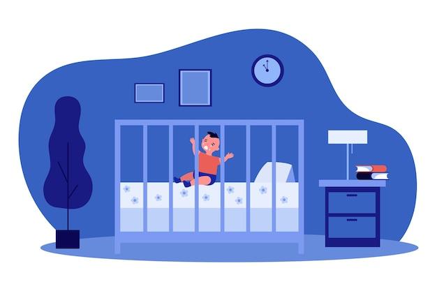 Маленький ребенок плачет в кроватке ночью.