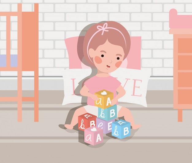 Little baby girl playing with alphabet blocks