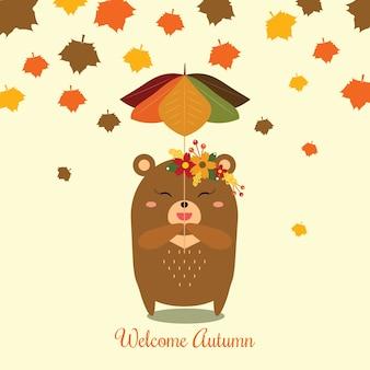 Little bear holding a leaf umbrella