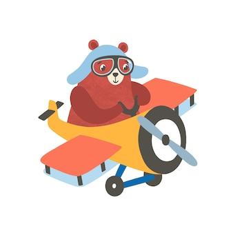 飛行機のフラットイラストの小さなクマ。航空機で飛んでいる幸せな小さなグリズリー