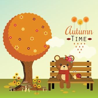 Маленький медведь, сидящий на скамейке осенью