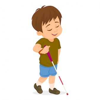 Little blind boy walking with cane stick