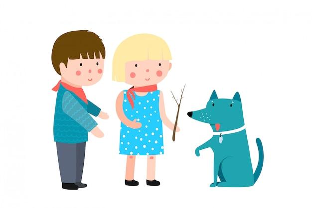 男の子と女の子の犬と遊ぶ