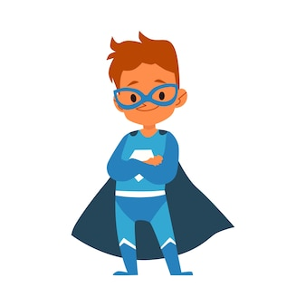 Little boy in blue superhero costume standing folded arms cartoon style,  isolated on white background. boy child dressed in cape and mask in brave heroic pose with crossed arms