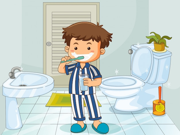 Little boy brushing teeth in toilet