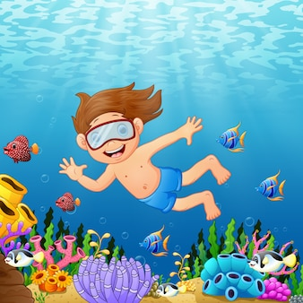 Little boy diving in the sea