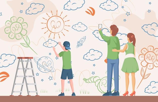 壁に絵を描く小さな男の子