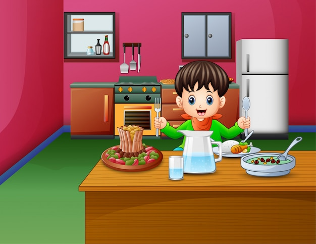 Little boy eats sitting at the dining table