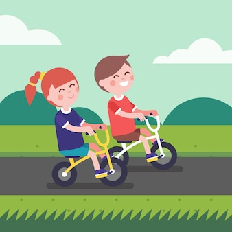 Little boy and girl kids riding bicycle