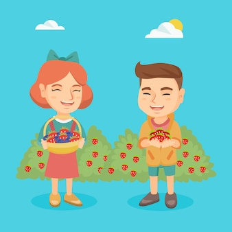 Little boy and girl with strawberry and blueberry.