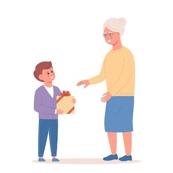할머니에게 선물을 주는 어린 소년 손자와 할머니가 함께 시간을 보내고 있다