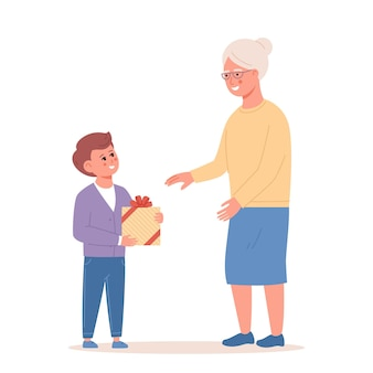 Little boy giving a present to grandma grandson and grandmother spending time together