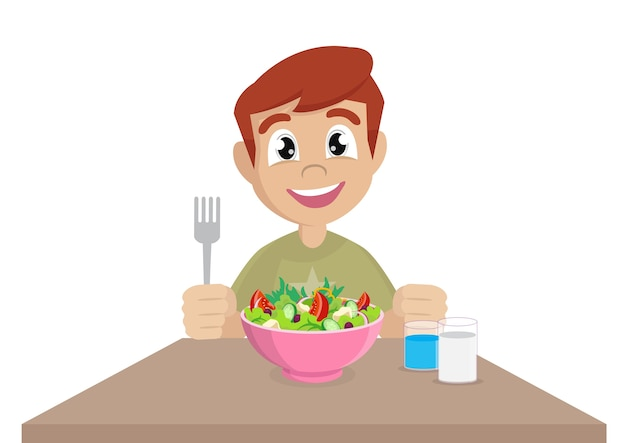 A little boy happy to eat salad