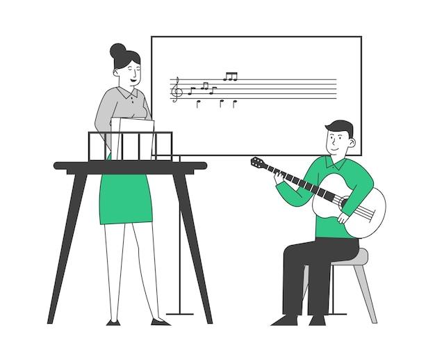 Little boy having lesson in music school