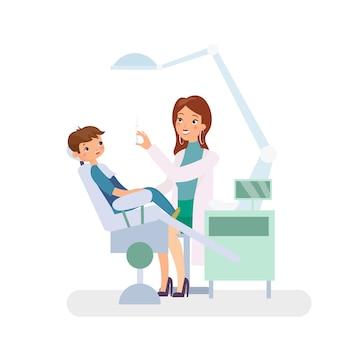 歯科医院の小さな男の子。医学、歯科。歯科医の椅子の医者の女性と子供の患者。