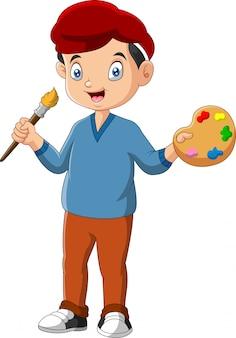 Little boy is holding paintbrush