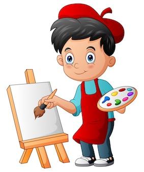 小さな男の子は絵筆のイラストで絵を描いています