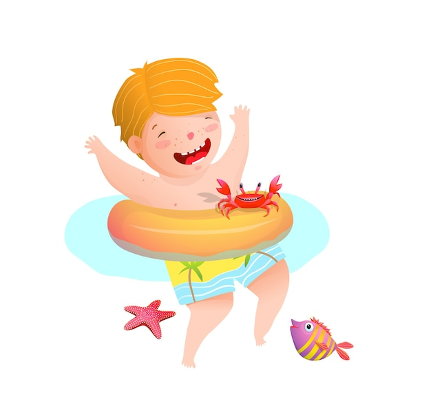 Little boy kid playing with sea crab fish and star in the ocean swimming with inflatable ring.