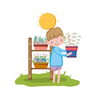 Little boy lifting houseplant with shelf in the garden