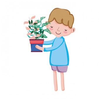 Little boy lifting houseplant