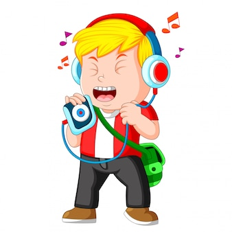 Little boy listening to music and singing