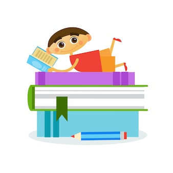 Little boy lying on stack of books reading cute kid
