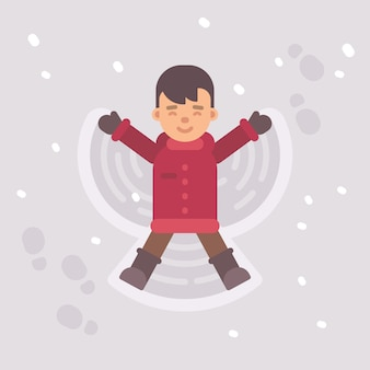 Little boy making a snow angel