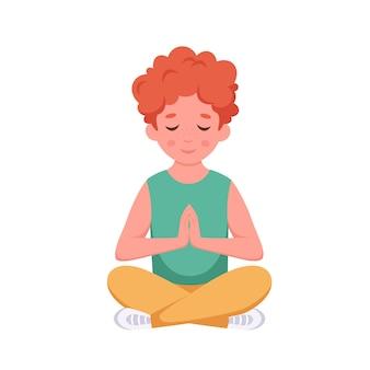 Little boy meditating in lotus pose gymnastic meditation for children