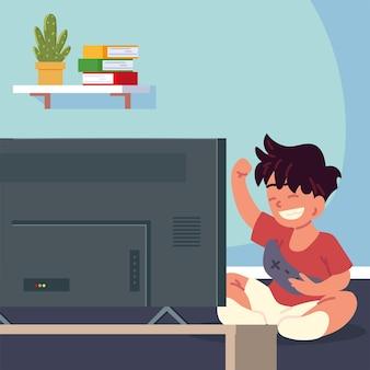 Маленький мальчик играет в видеоигры
