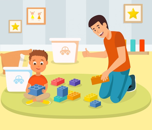 Little boy playing building blocks with father