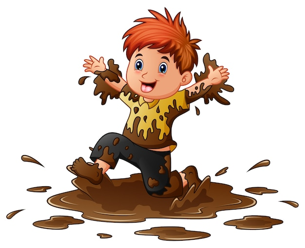Little boy playing in the mud
