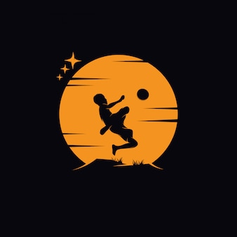 A little boy playing soccer on the moon