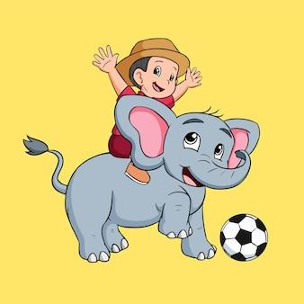 Маленький мальчик играет со слоном