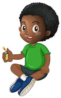 Маленький мальчик играет с зажигалкой