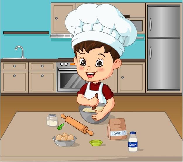부엌에서 음식을 준비하는 어린 소년