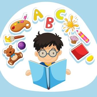 本を読んでいる小さな男の子
