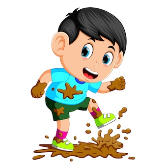 Little boy running in the mud