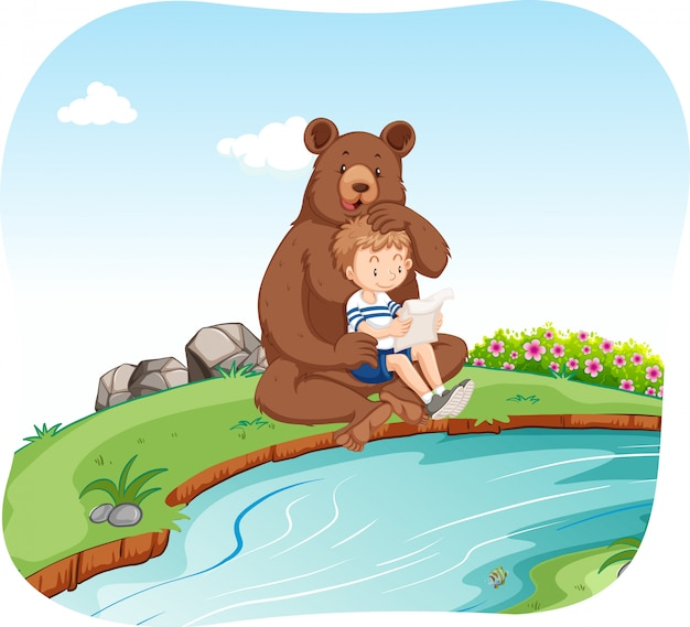 Little boy sitting with bear by the river