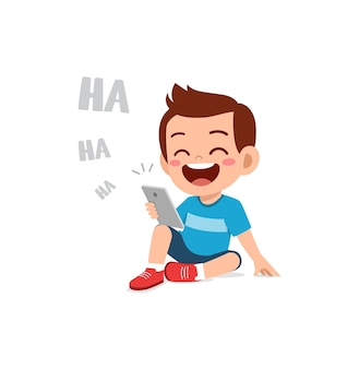 Little boy using mobile phone and laugh