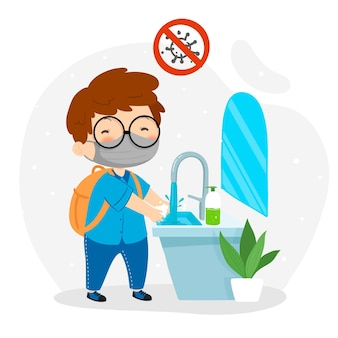 学校で手を洗う少年