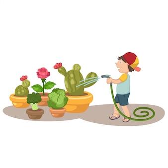 Маленький мальчик поливает деревья