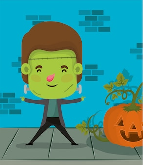 Little boy with costume of frankenstein and pumpkin